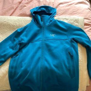 Bright blue Arcteryx men's hoodie